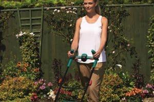 Bosch Rotak 32 LI High Power Cordless Lawn Mower woman pushing