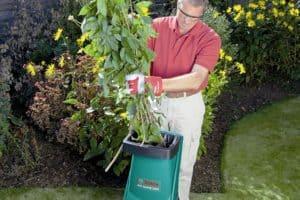 Bosch AXT Rapid 2200 Blade Garden Shredder inserting brnaches
