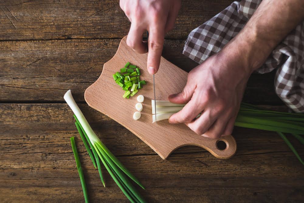 Man chopping spring onions