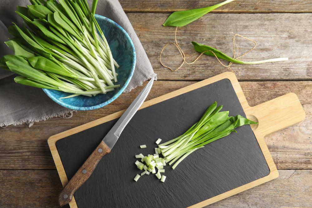 Wild garlic leaves on chopping board