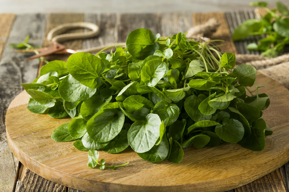 Watercress on chopping board